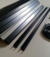 Black Tambour door slat with pearl white finger rail